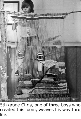 elementary school boy weaving on a hand loom