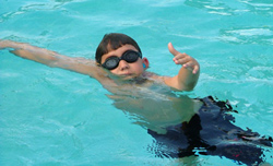 boy swims at an angle