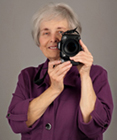 Portrait of Sheila Finkelstein with camera